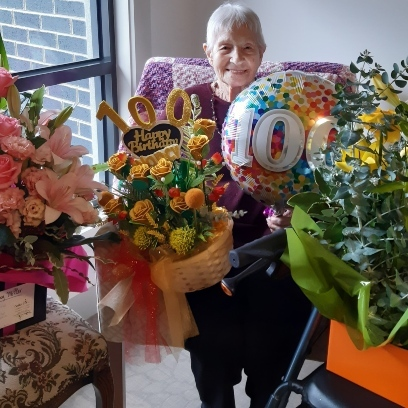 Photo of Nancy celebrates 100 years with staff and residents